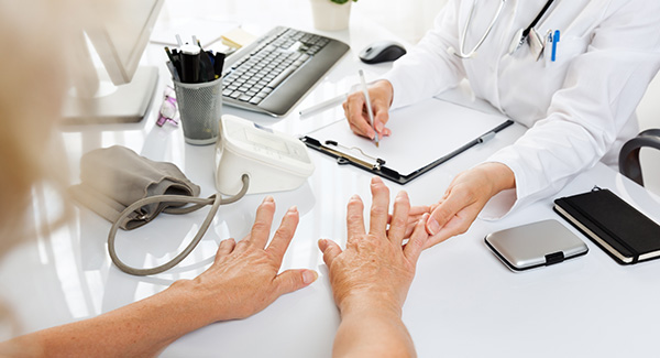 doctor examining a womans hands
