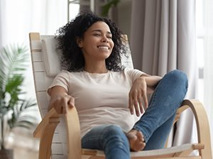 Woman relaxing in chair at home